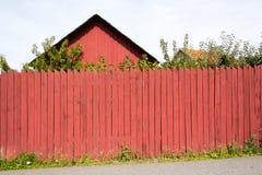 瑞典木屋和篱芭 库存图片