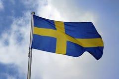 瑞典,在蓝色背景的黄色十字架,国家标志的旗子 库存图片