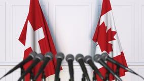 瑞士和加拿大的旗子在国际会议或交涉新闻招待会 影视素材