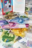 瑞士护照和金钱 免版税库存照片