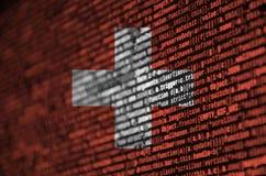 瑞士旗子在有节目代码的屏幕上被描述 现代技术和地点发展的概念 库存照片