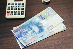 瑞士法郎金钱和计算器财务概念 库存图片
