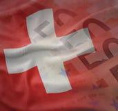 瑞士的五颜六色的挥动的国旗欧元金钱钞票背景的 免版税库存图片