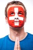 瑞士足球迷画象祈祷瑞士国家队 免版税库存照片