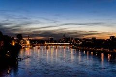 瑞士,在河莱茵的看法在日落的巴塞尔 库存图片