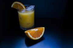 玻璃汁液桔子 图库摄影
