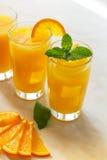玻璃汁液桔子 免版税库存照片