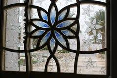 玻璃污点蓝色花 库存图片