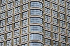 玻璃现代门面办公楼  免版税库存照片
