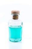 玻璃瓶土耳其玉色液体 库存照片