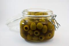 玻璃瓶子在白色背景的橄榄 免版税库存照片