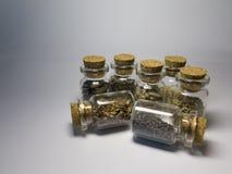 玻璃瓶子用健康食物, Chia,向日葵种子,芝麻籽 免版税库存图片