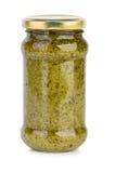玻璃瓶子用pesto调味汁 免版税库存图片