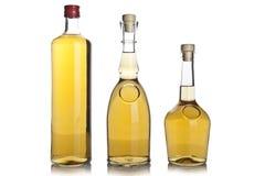 玻璃瓶白兰地酒 库存照片