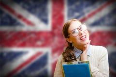 玻璃的俏丽的女孩微笑在英国联合的 免版税库存照片