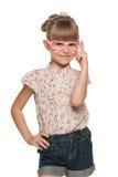 玻璃的快乐的小女孩 库存图片