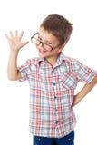玻璃的愉快的小男孩 图库摄影