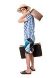 玻璃的年轻,英俊的人与两个袋子准备好对trave 库存照片