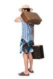 玻璃的年轻,英俊的人与准备好两个的袋子旅行 免版税库存图片
