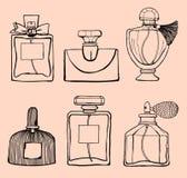 玻璃蓝色香水瓶 免版税库存图片