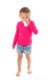 玻璃饮用的女孩少许牛奶 免版税库存图片