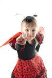 瓢虫服装的女孩在空白背景 库存图片