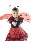 瓢虫服装的女孩在空白背景 免版税库存照片