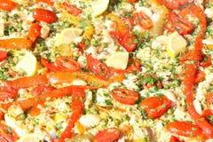 瓦伦西亚语肉菜饭背景用米和蕃茄 免版税图库摄影