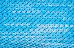 瓦屋顶,样式亚洲,房子覆盖物的瓦无缝的样式在蓝色颜色 免版税库存照片