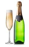 瓶和杯香槟 免版税库存图片