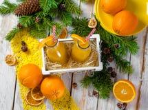 瓶图象查出的汁液桔子 库存图片