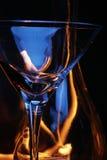 瓶在跟踪的火玻璃 免版税图库摄影