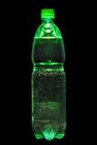 瓶奶油色绿色碳酸钠 免版税库存图片