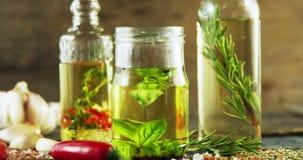 瓶子和瓶有橄榄油和草本的 影视素材