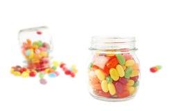 瓶子和软心豆粒糖的构成 库存照片