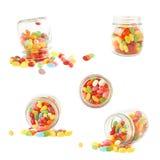 瓶子和软心豆粒糖的构成 免版税库存照片