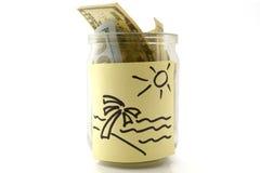 瓶子旅行的金钱 库存照片