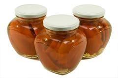 瓶子用卤汁泡的胡椒红色三 免版税库存图片