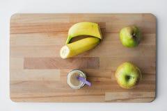 瓶子用果子纯汁浓汤或婴儿食品 库存图片