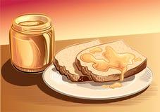 瓶子蜂蜜和面包 库存照片
