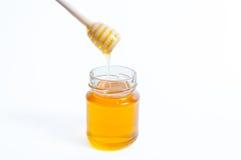 瓶子蜂蜜 图库摄影