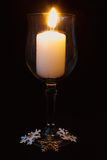 瓶子蜡烛有黑暗的背景 库存照片