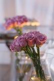 瓶子紫色玫瑰 库存照片