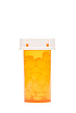 瓶查出的药片 免版税库存照片