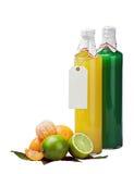瓶用查出的柑橘水果和空白标签汁液  免版税库存图片