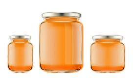 瓶用被隔绝的蜂蜜 免版税库存照片