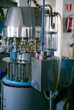 瓶装工业设备酒 免版税图库摄影
