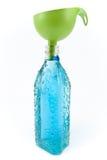 瓶水和漏斗 库存图片
