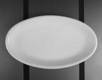 瓷圆的方形的浅盘 免版税库存照片