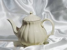 瓷茶壶抽象背景  免版税库存图片